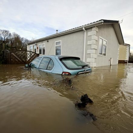 Car and House submerged in Water